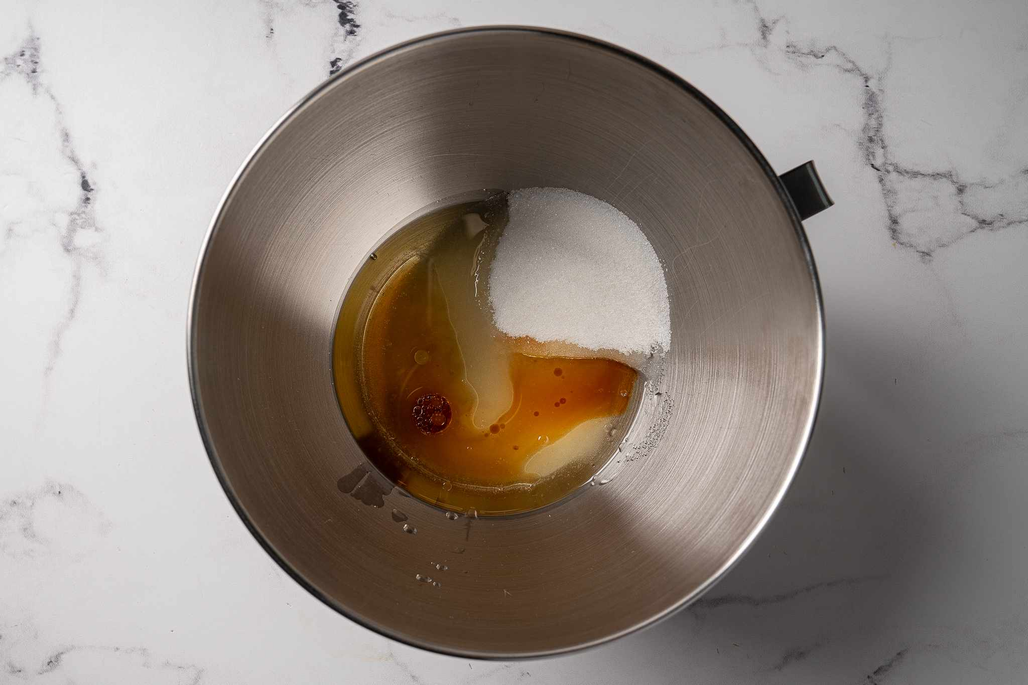 Sugar and wet ingredients in a bowl