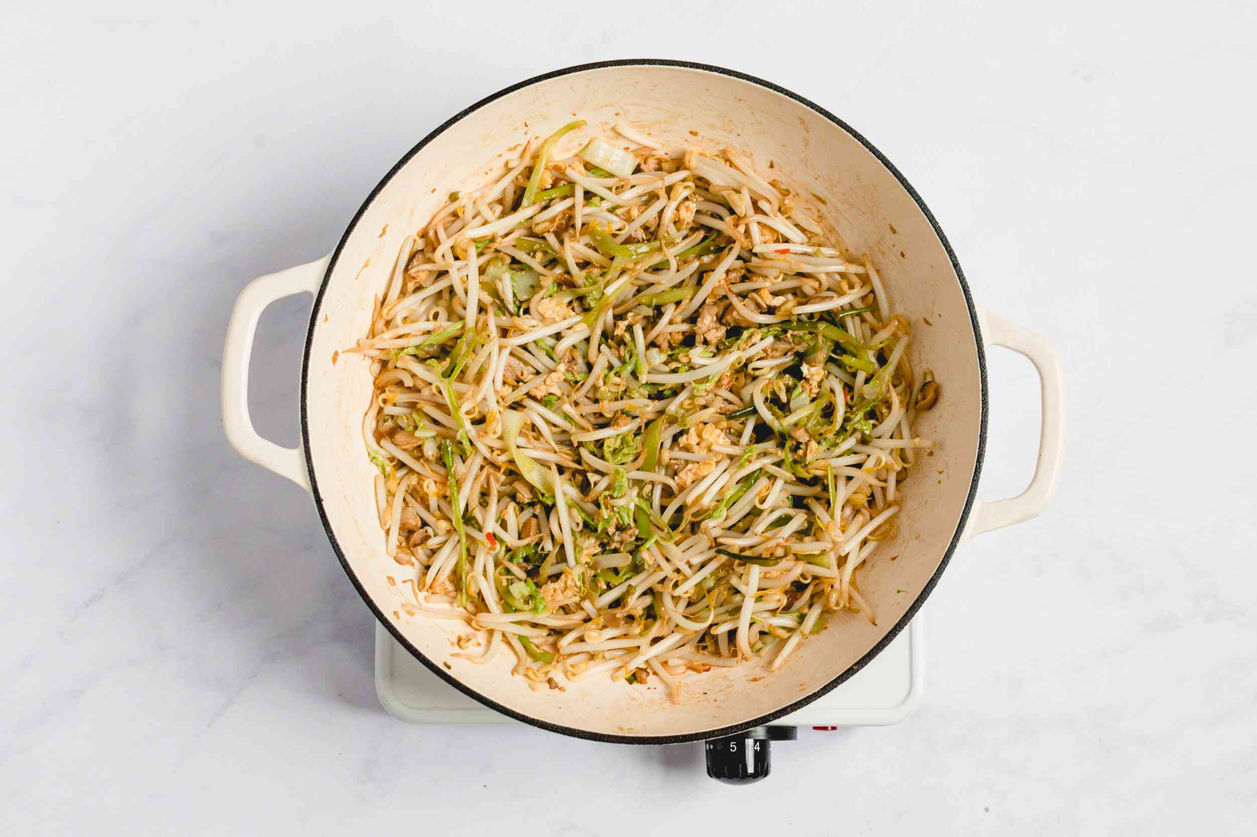 add bean sprouts to the vegetables in the pan