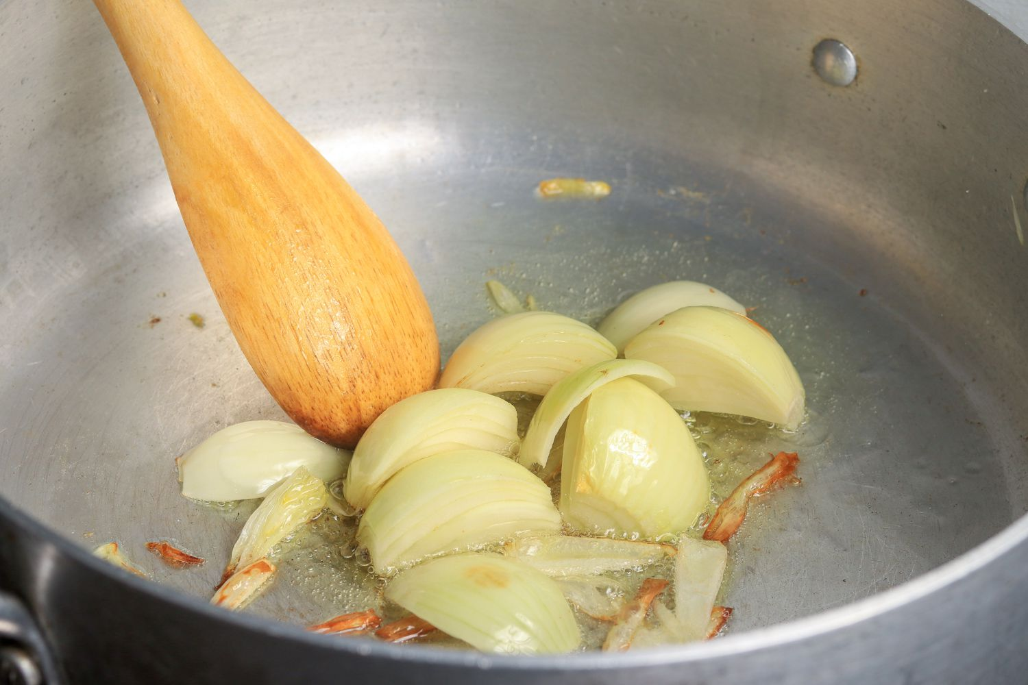 Onions cooking down in pan