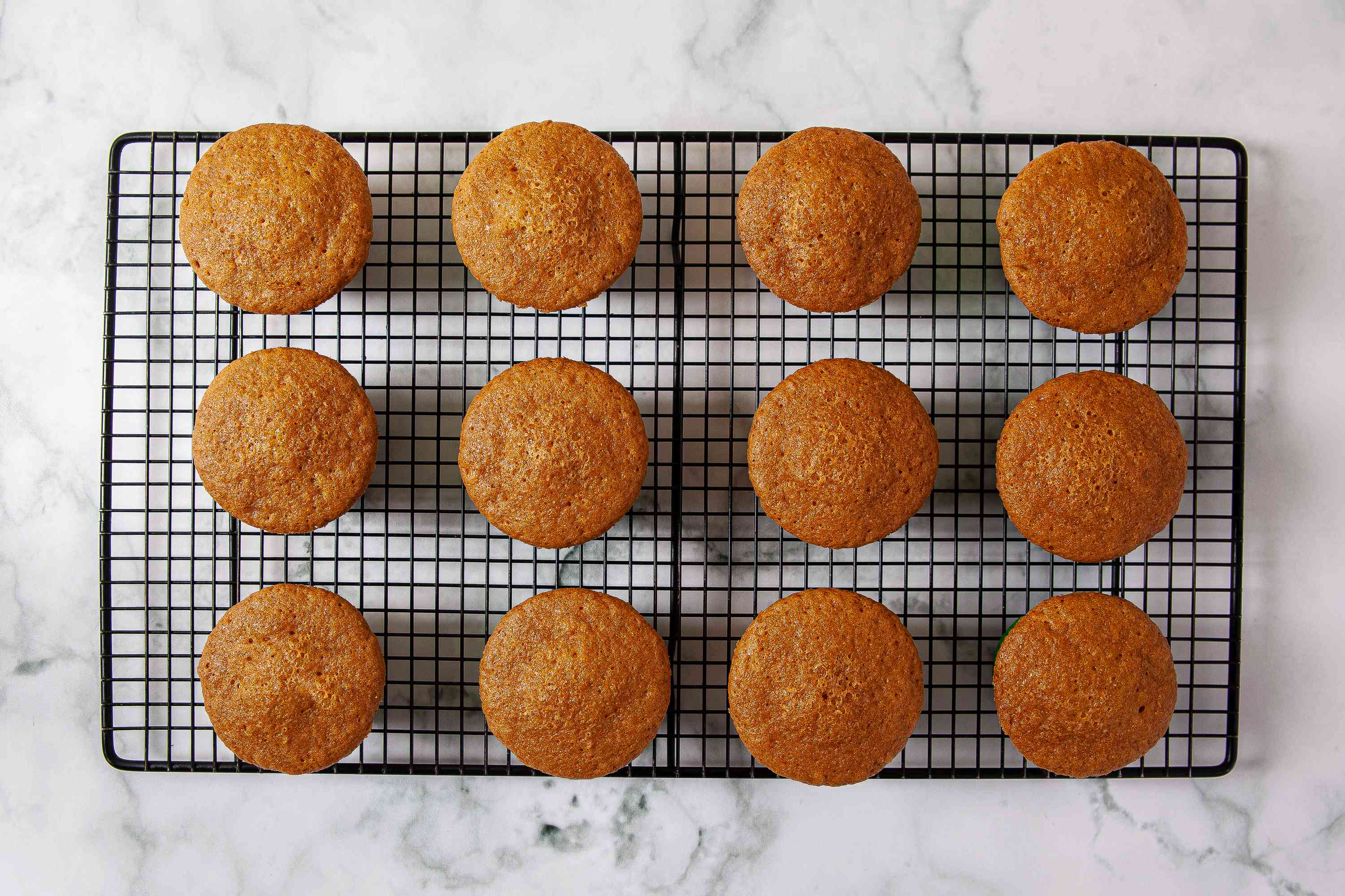 Carrot Cake Cupcakes cooling on a wire rack