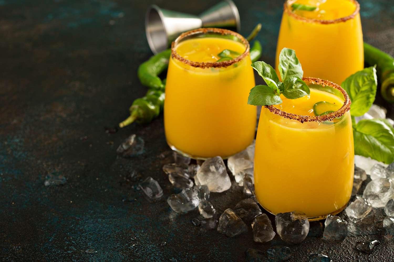 Spicy mango margaritas with basil