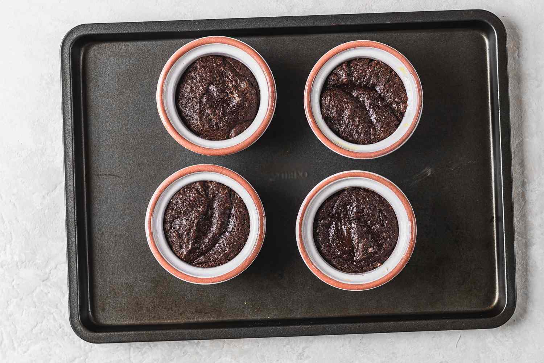 custard cups on a baking sheet