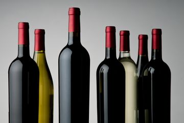 Close-Up Of Wine Bottles Over White Background
