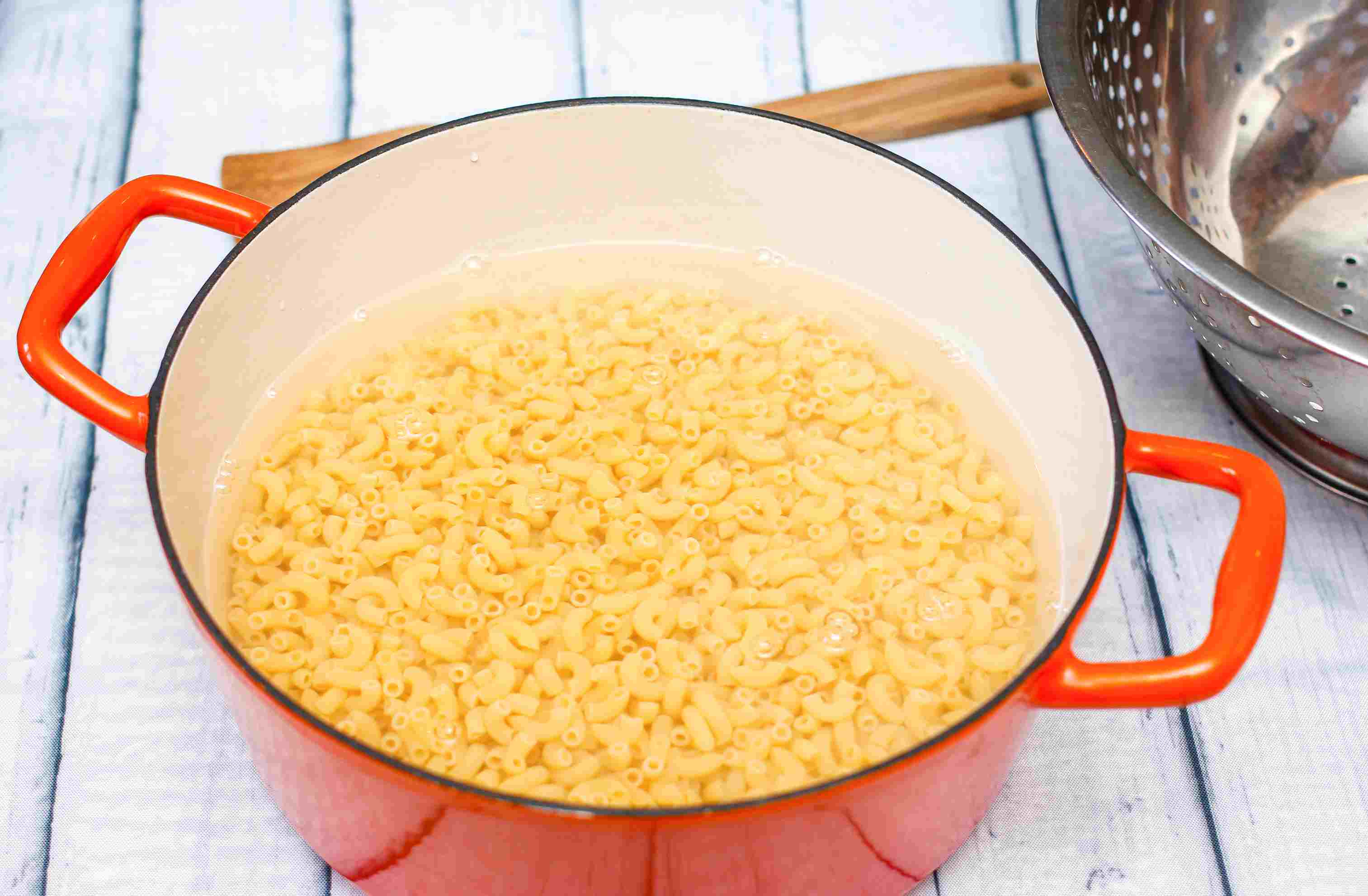 Elbow macaroni in boiling water in a large pot