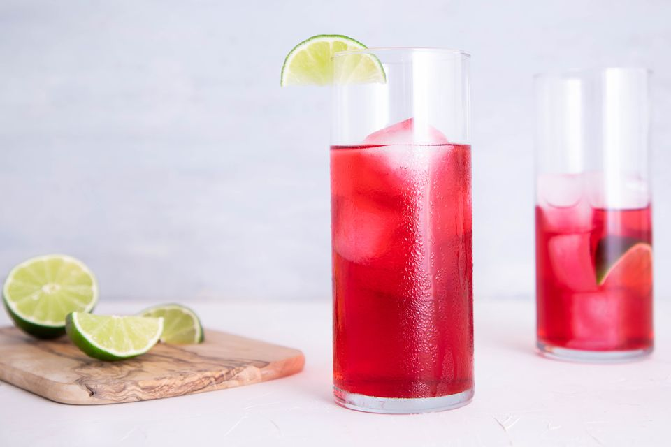 Cape Cod: the Popular Vodka and Cranberry Drink recipe, in a glass with lime wedges