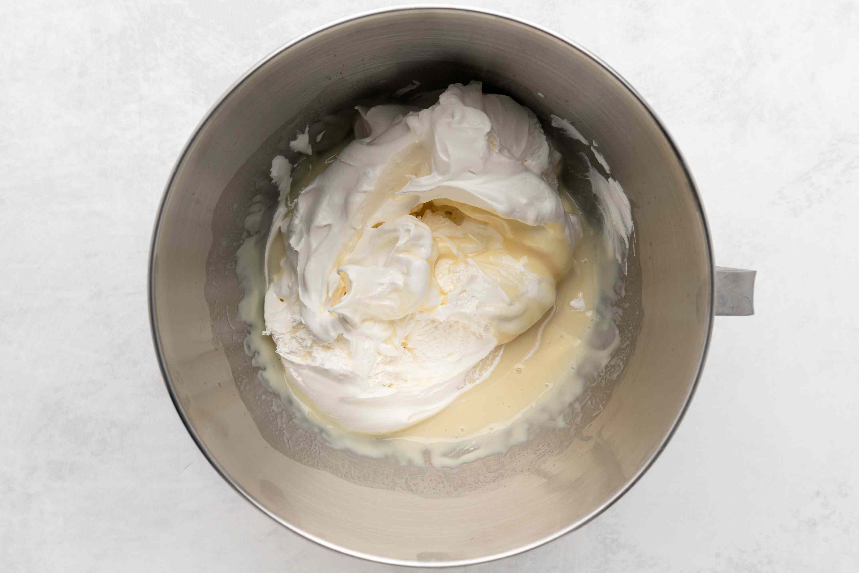 beat lemonade and condensed milk together and add whipped topping