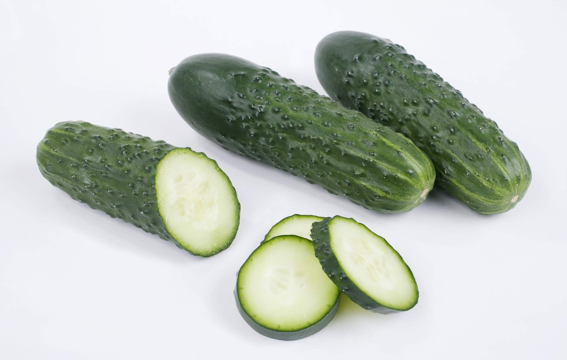 Fresh cucumbers and slices