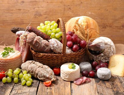 wicker basket with cheese and charcuterie
