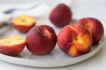 Cutting up peaches.
