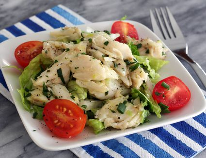 Crabmeat saute with tomatoes on plate