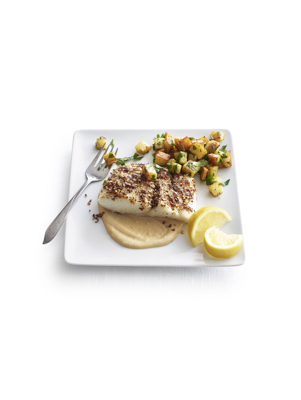 Roasted halibut with tahini sauce & diced potatoes
