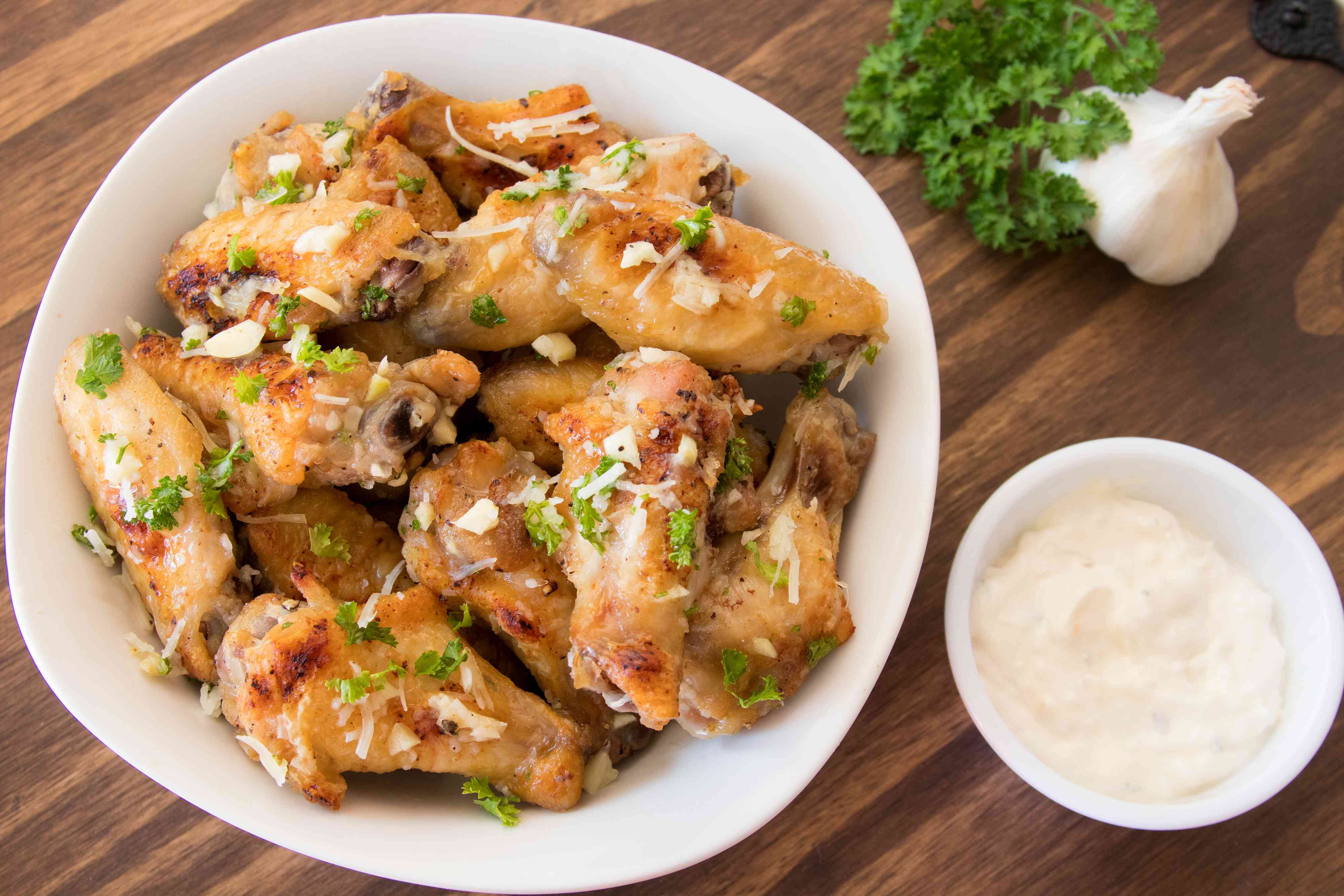 Garlic-Parmesan chicken wings with sauce