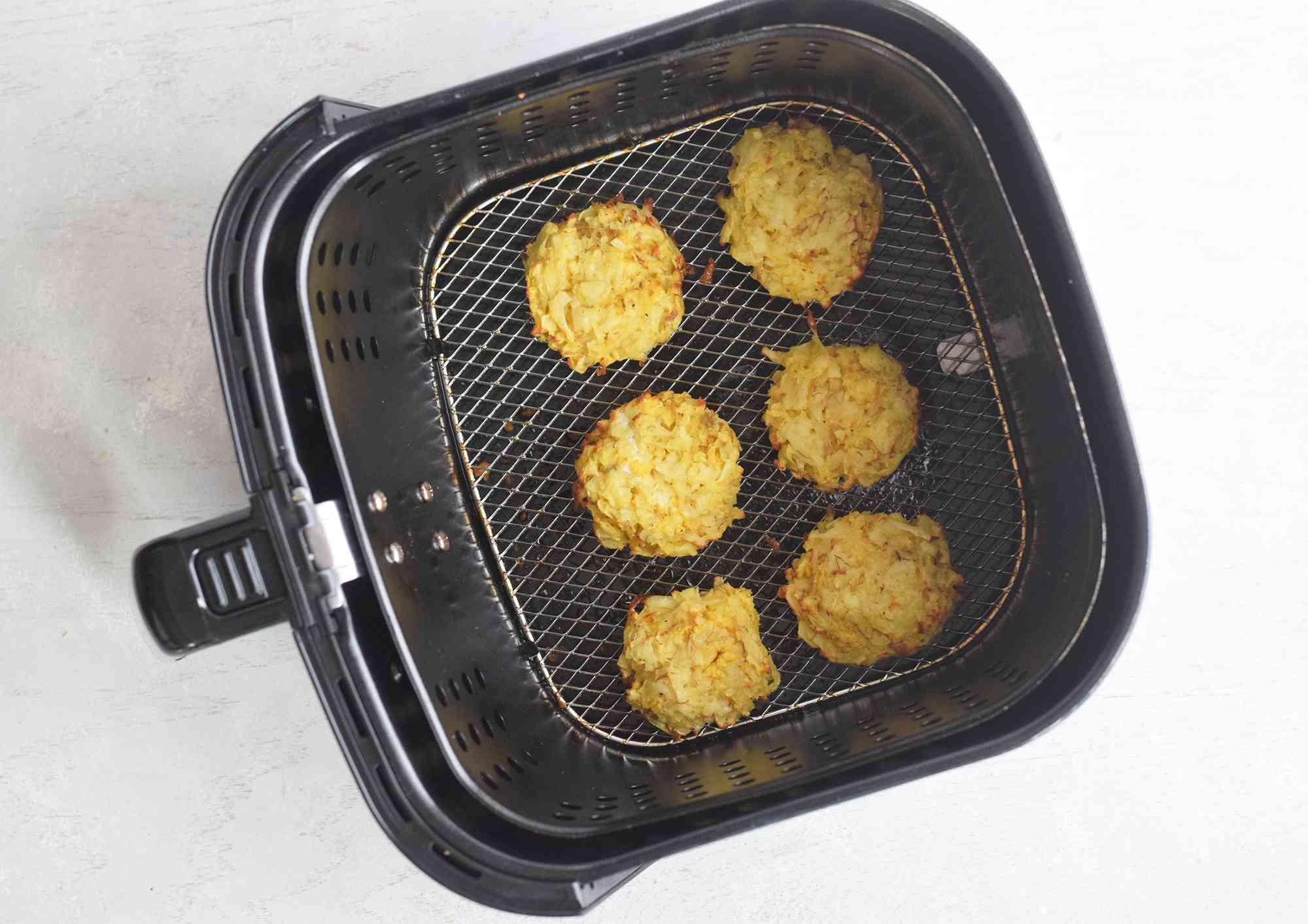 Latkes browning in an air fryer