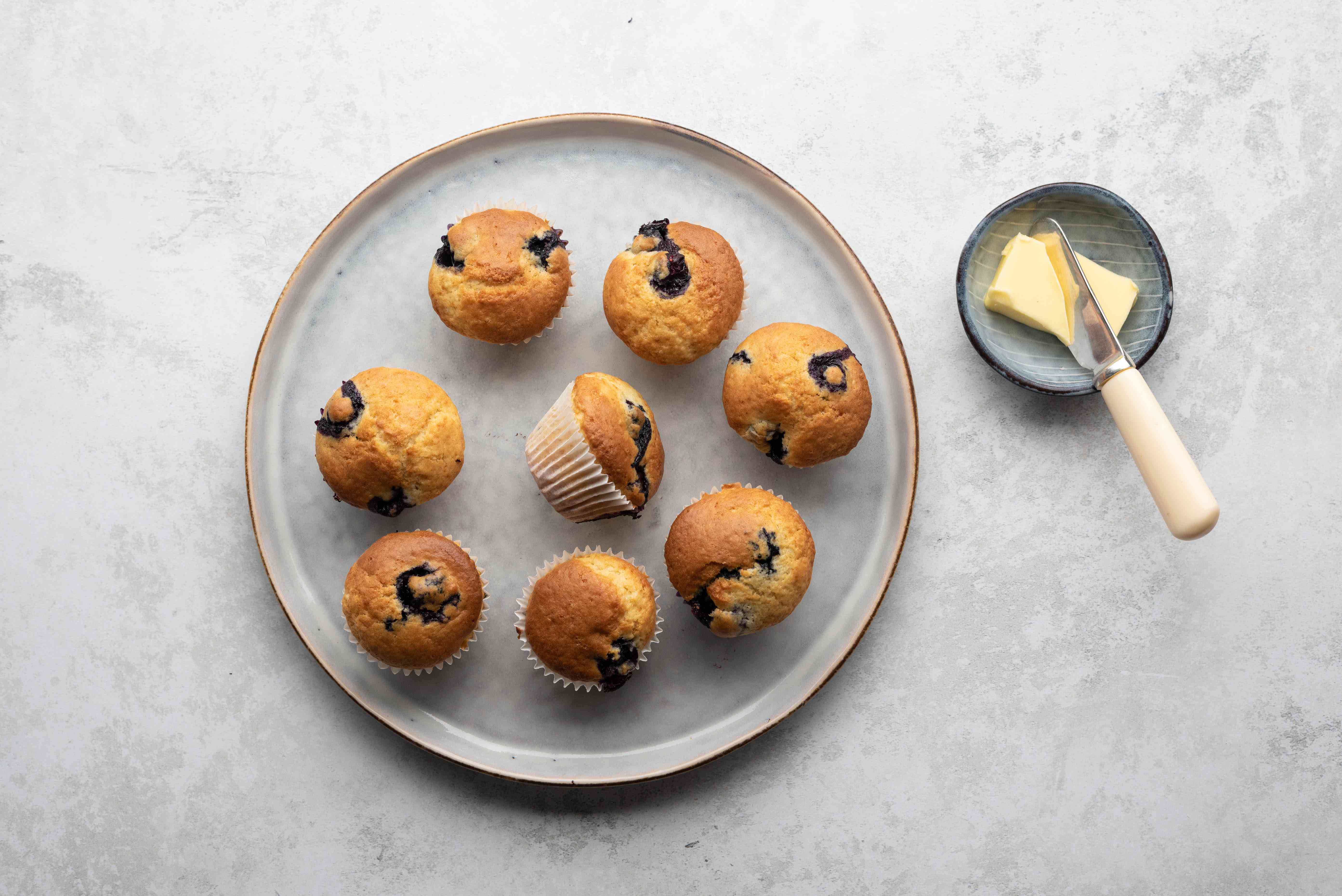 Mini Blueberry Muffins on a plate, served with butter