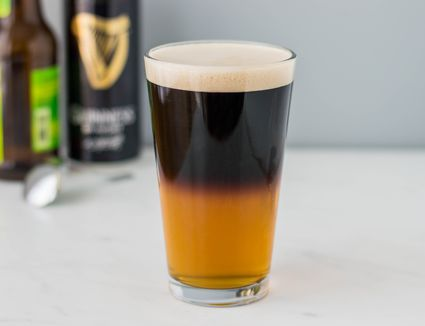 Black and tan beer in a pint glass