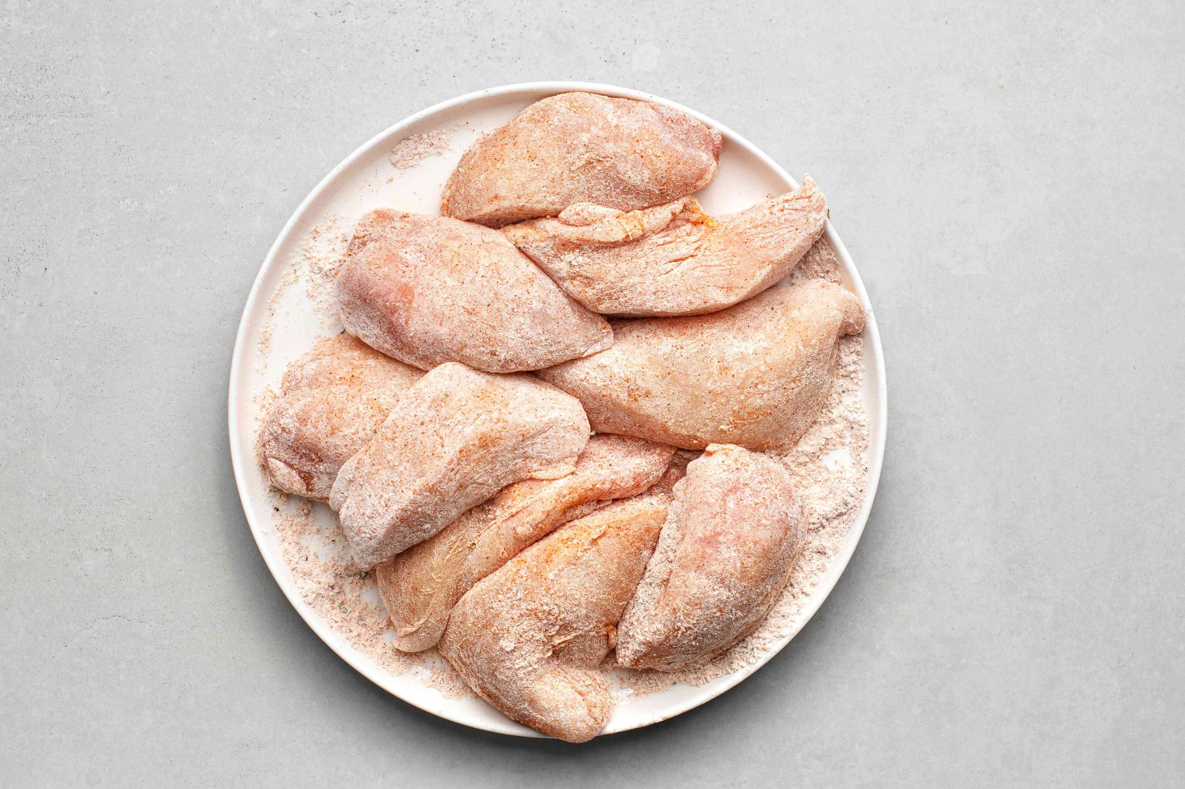 coat chicken in the flour and seasoning mixture