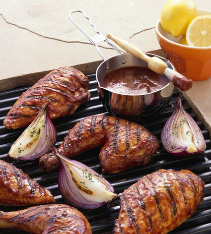 BBQ chicken and onions on a grill
