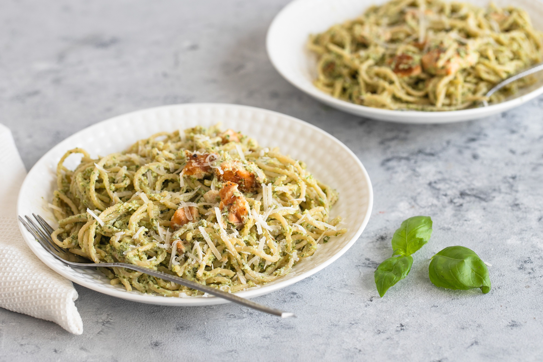 Pesto salmon pasta served with Parmesan cheese