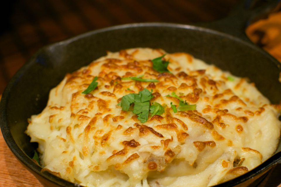 potato casserole with shredded cheese