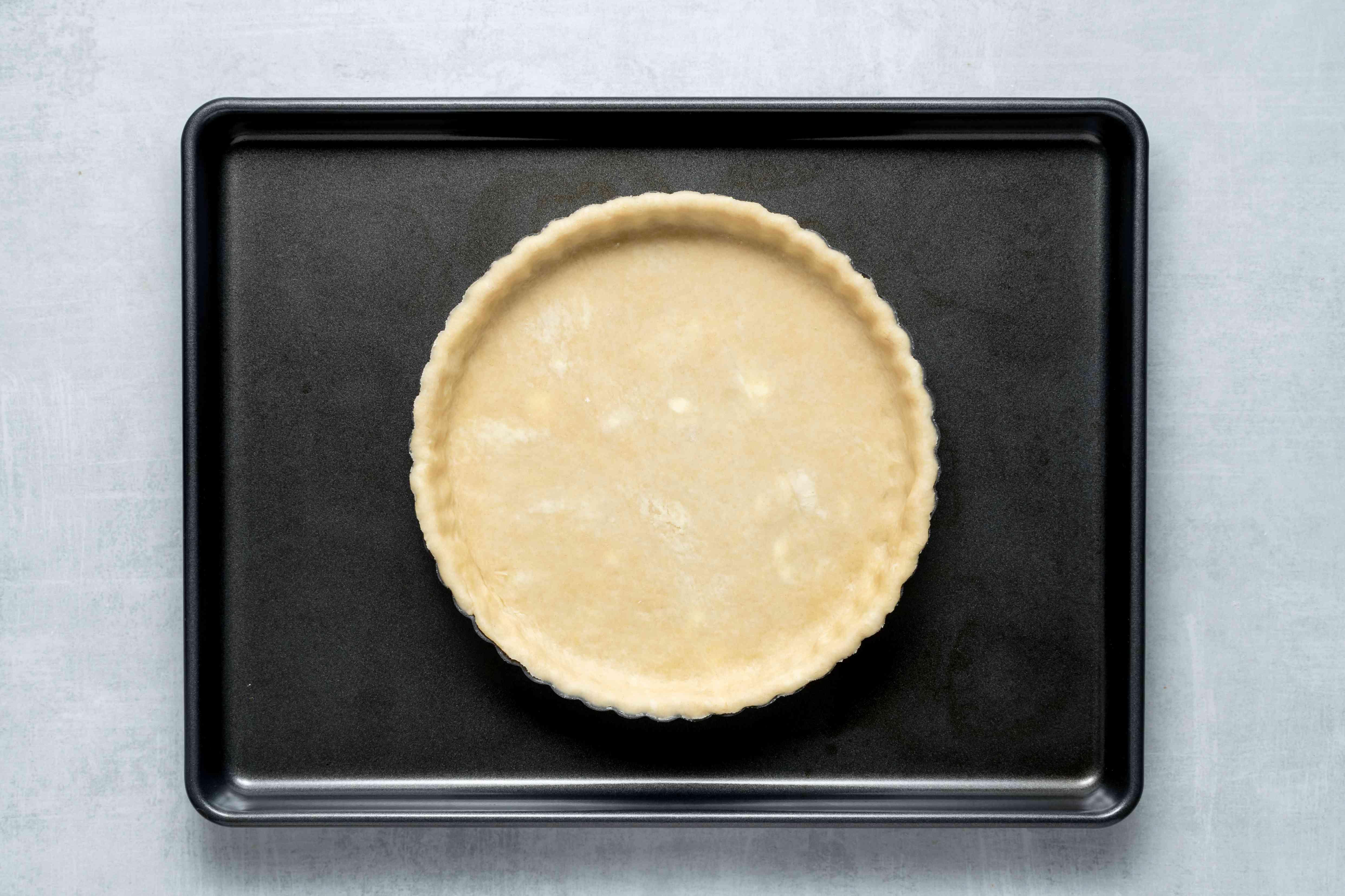 tart pan on a baking sheet