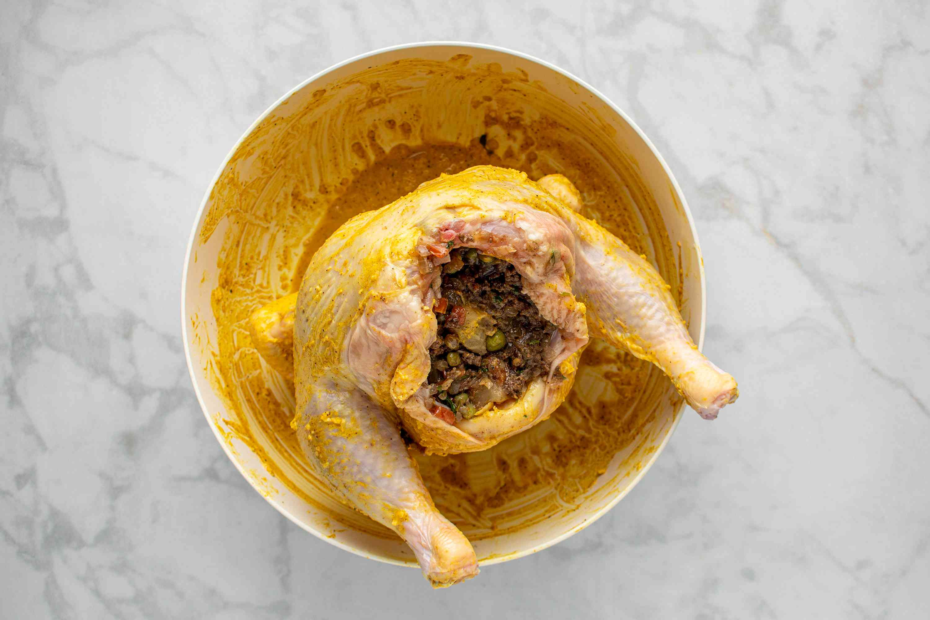 chicken filled with the meat and vegetable filling in a bowl