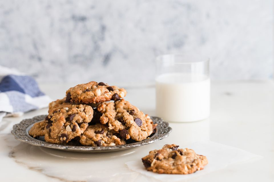 cowboy cookies with a glass of milk