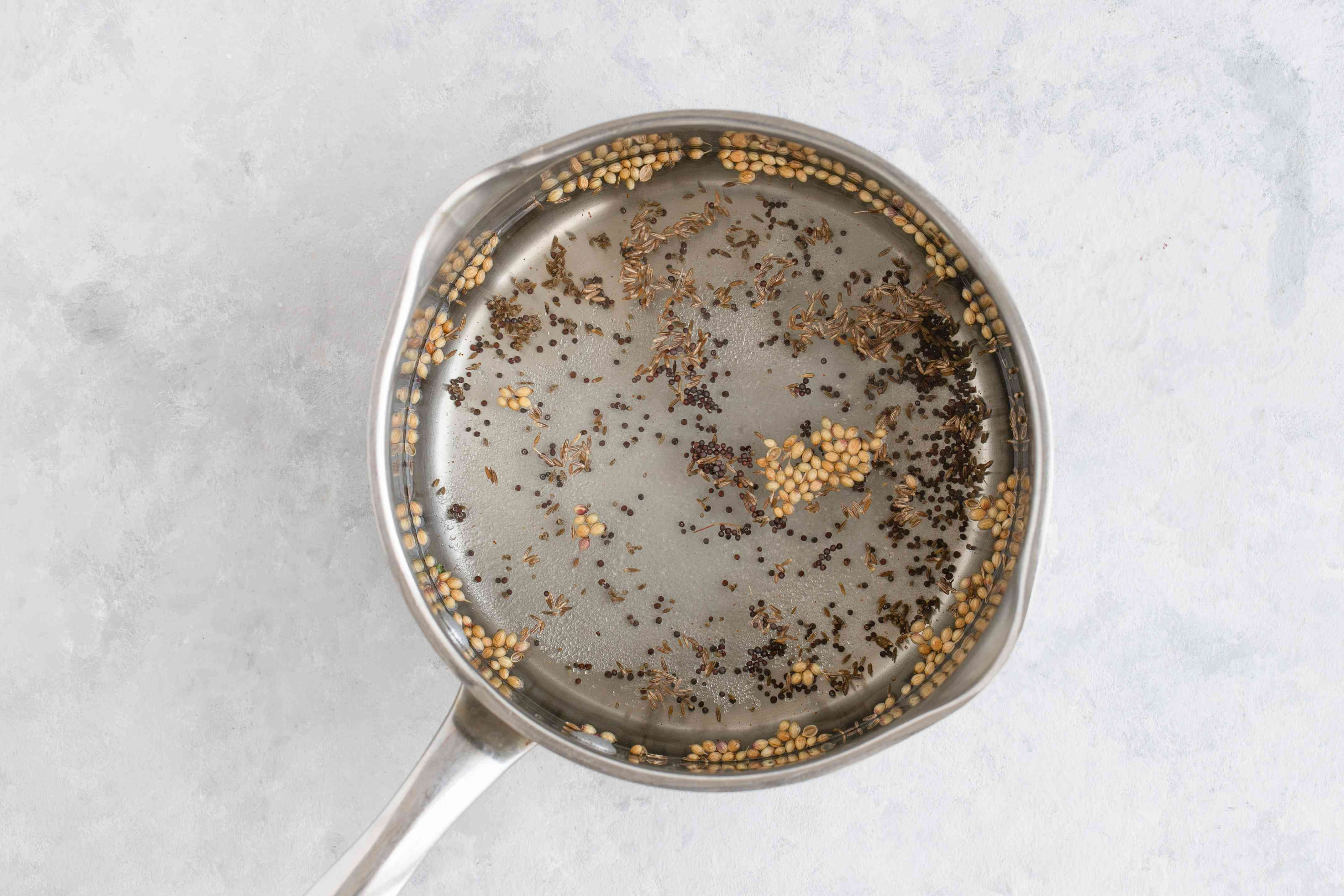 Combine vinegar and spices