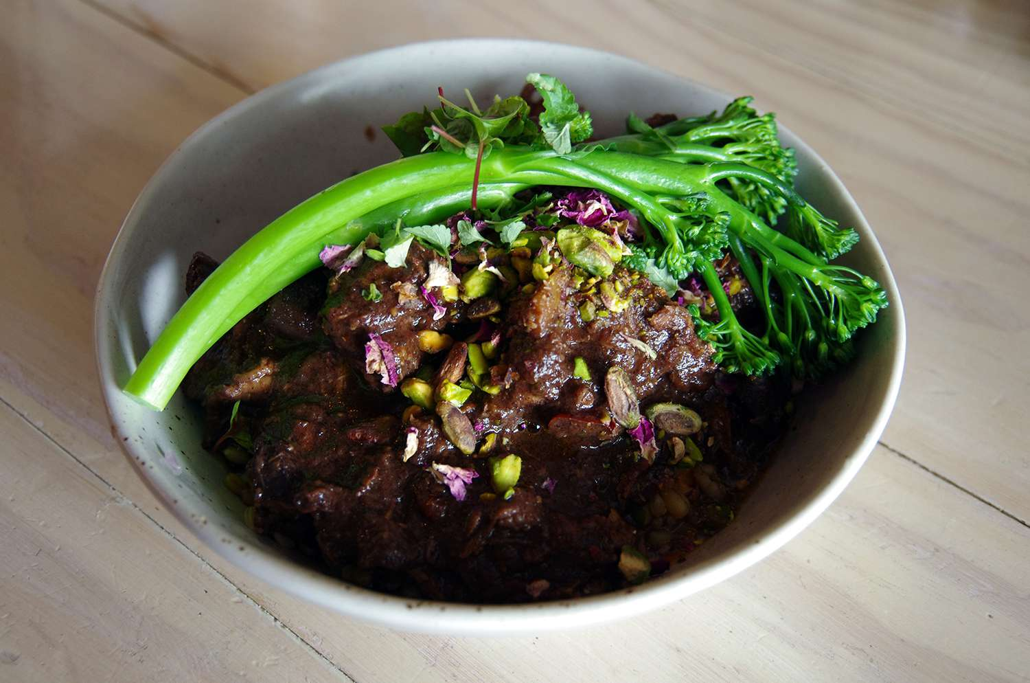 Moroccan-style lamb with pistachios and broccolini