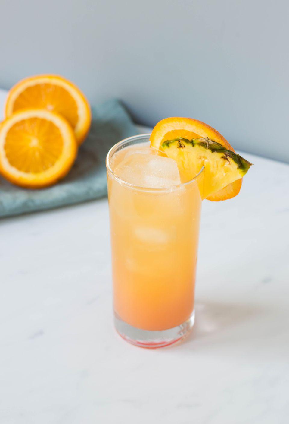 Cinderella non-alcoholic mocktail with orange and pineapple garnish