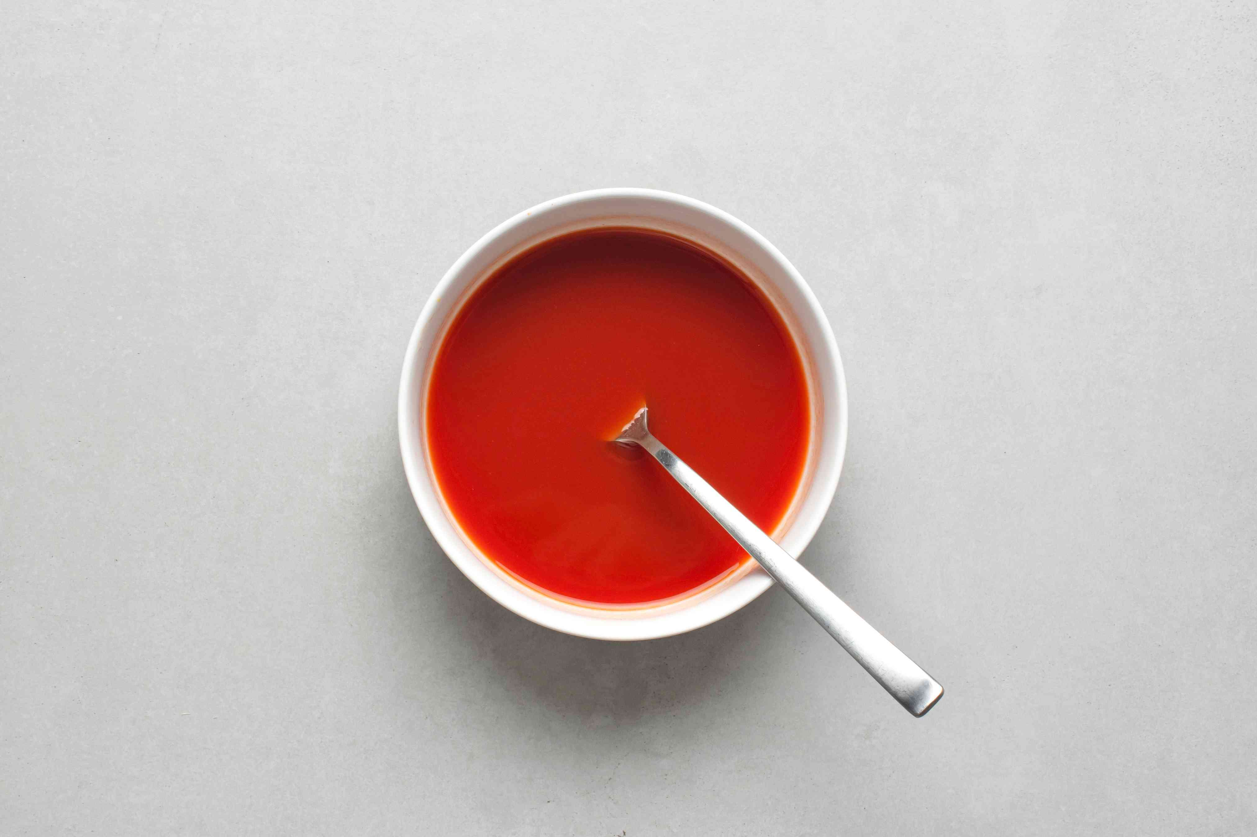 A bowl of wine and tomato paste mixture
