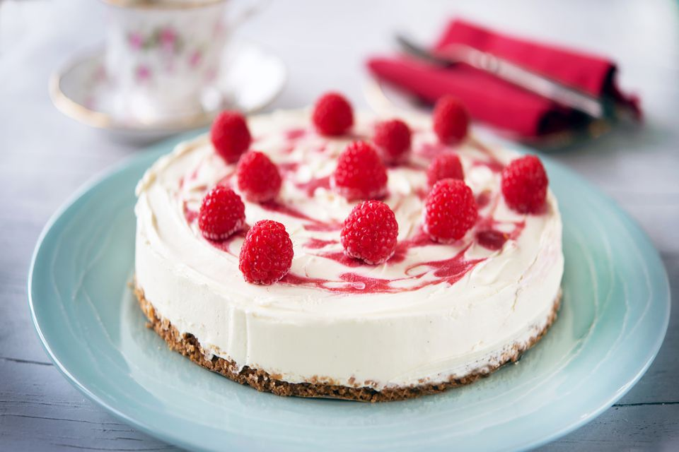 White chocolate cheesecake topped with fresh raspberries
