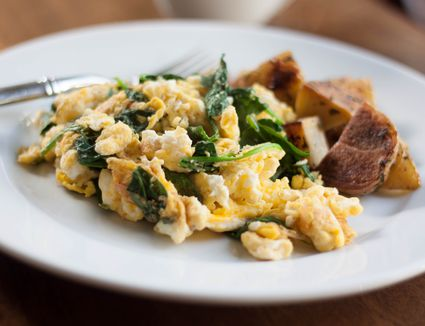 Spinach and egg scramble with roasted potatoes