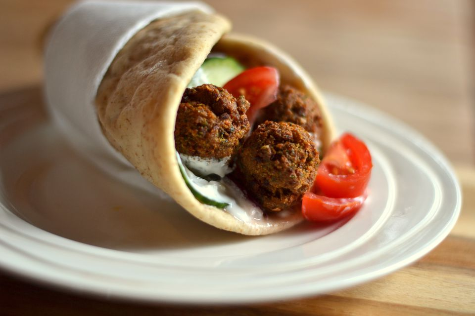 Top 10 middle eastern recipes for beginners close up of falafels in wrap sandwich on plate forumfinder Image collections
