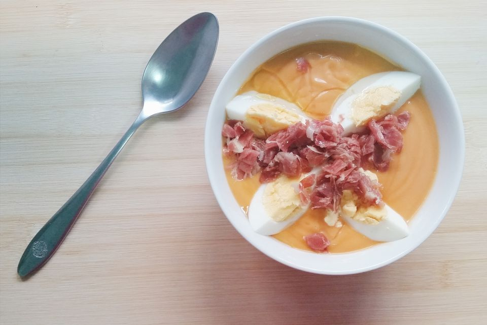 Bowl of salmorejo soup with boiled eggs and serano ham