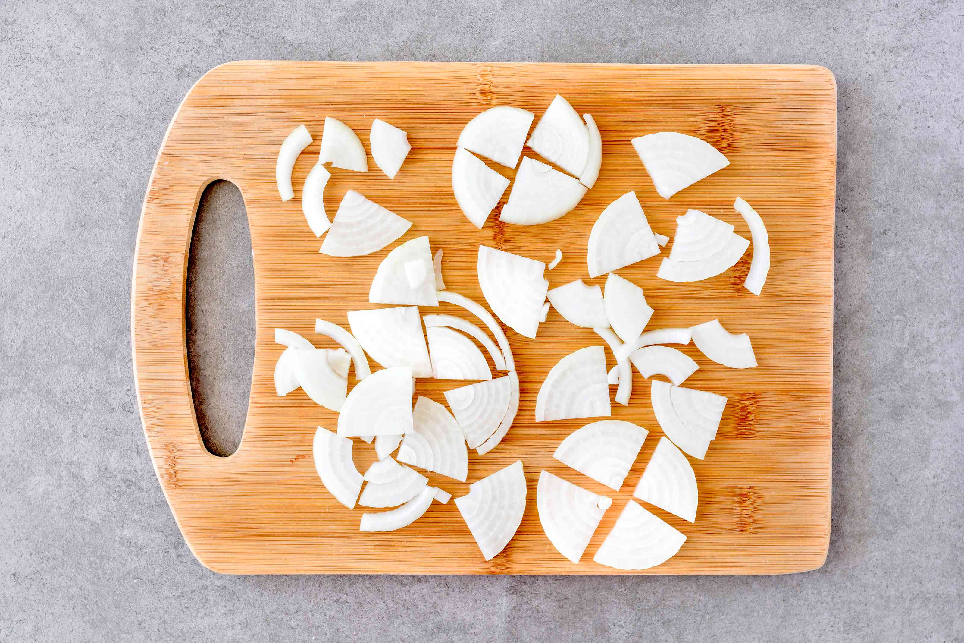 Cut round onion slices in half and then half again