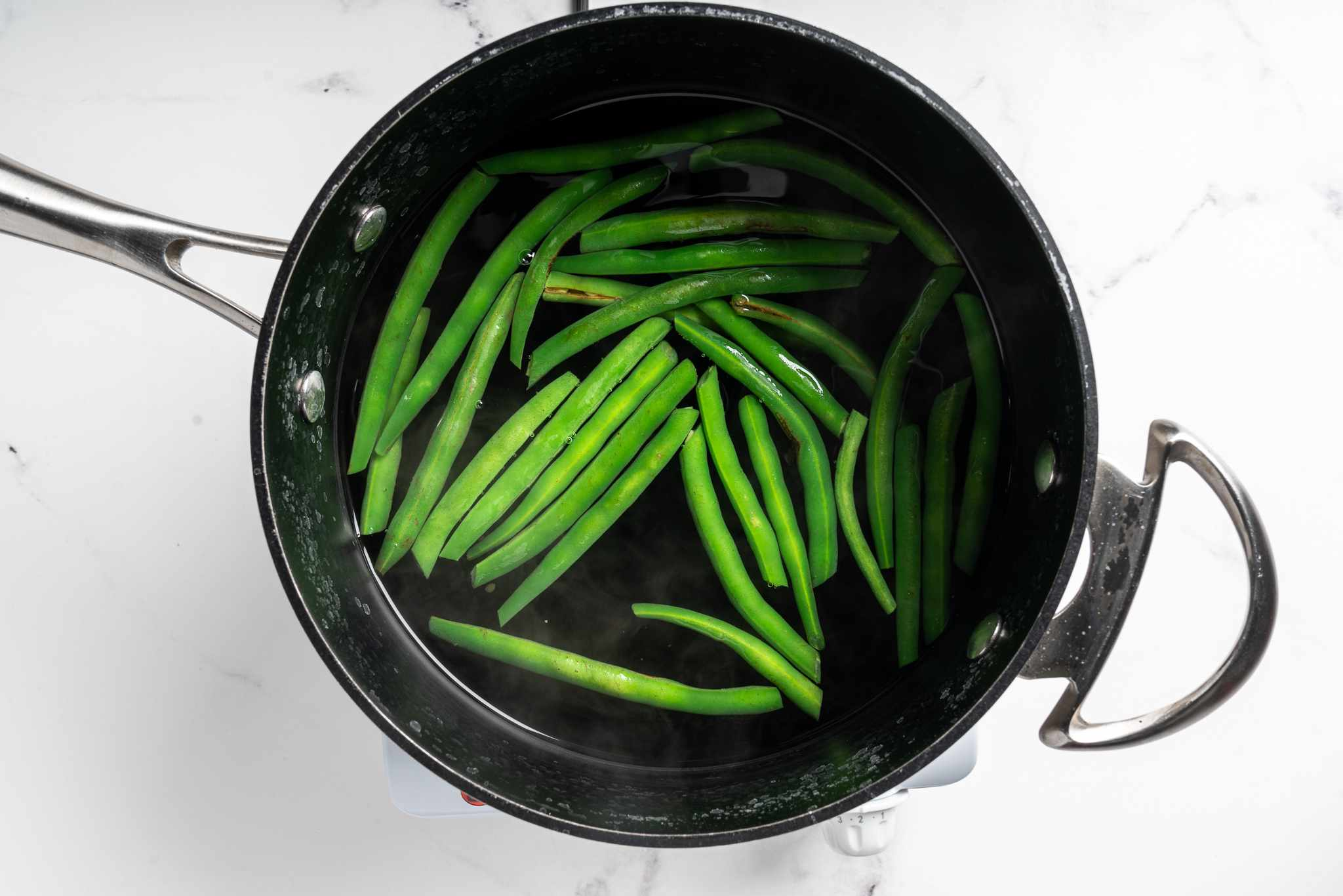 green beans in a pot with water