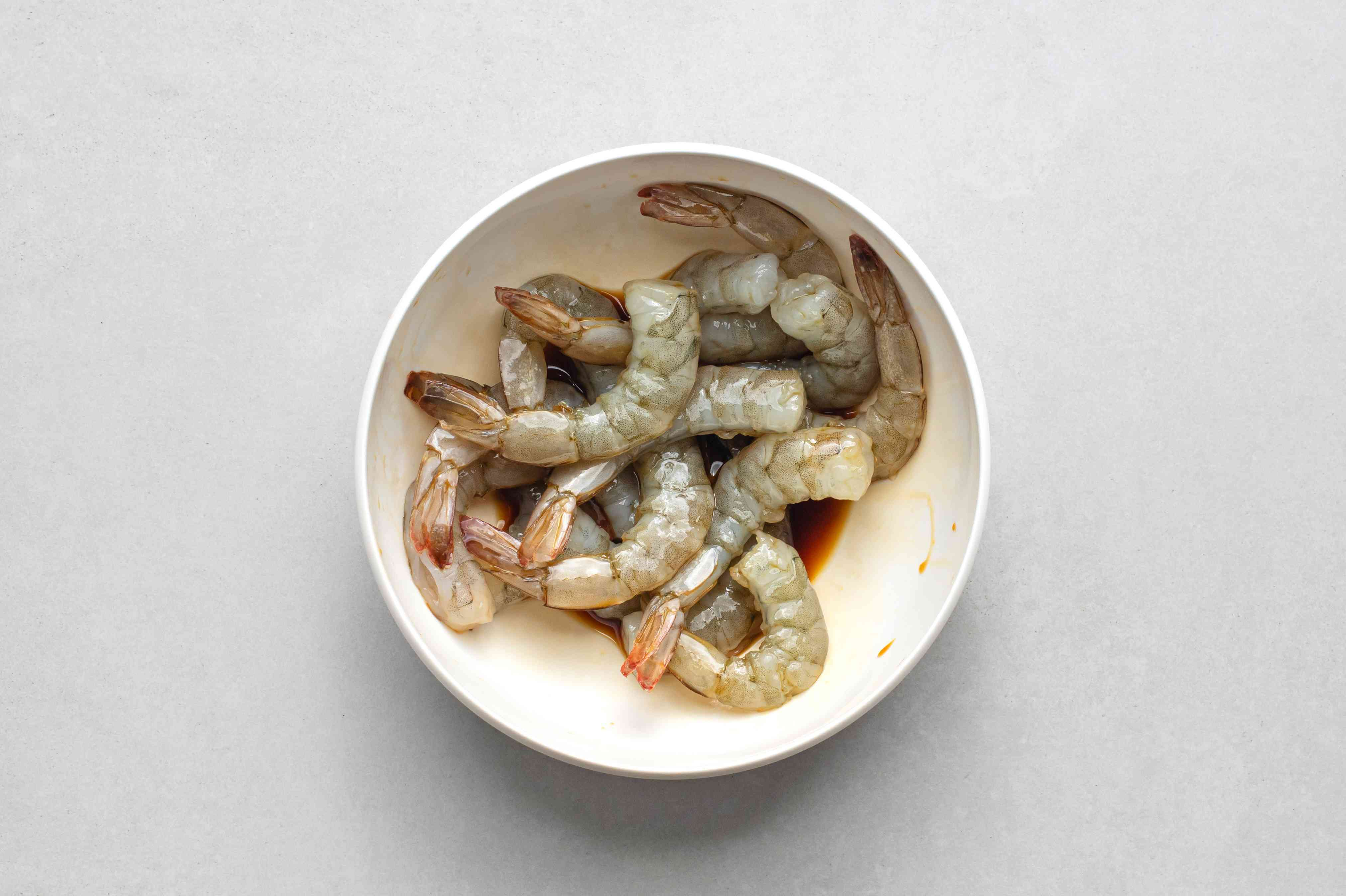 toss the shrimp with the tamari in a bowl