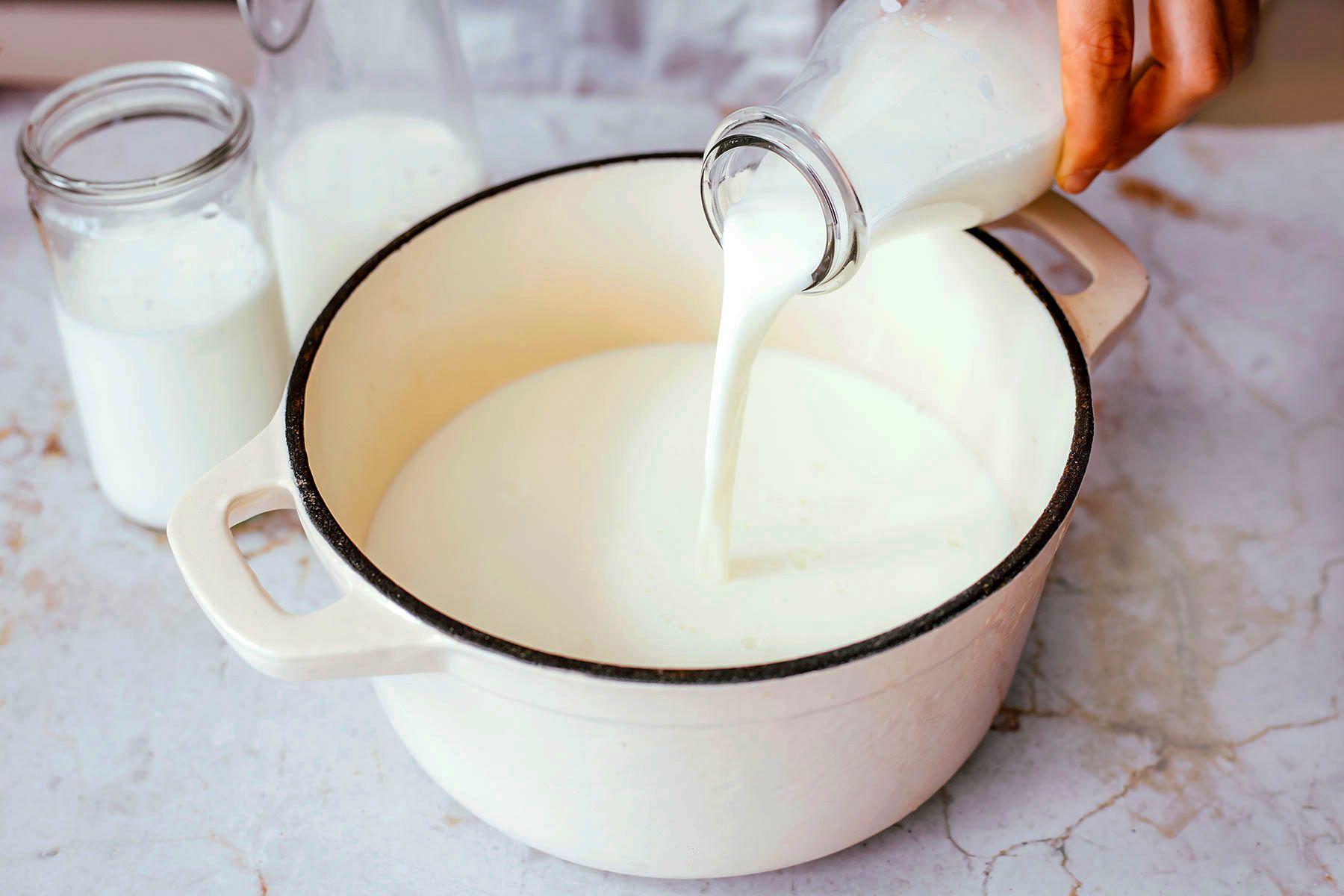 pour milk into pot