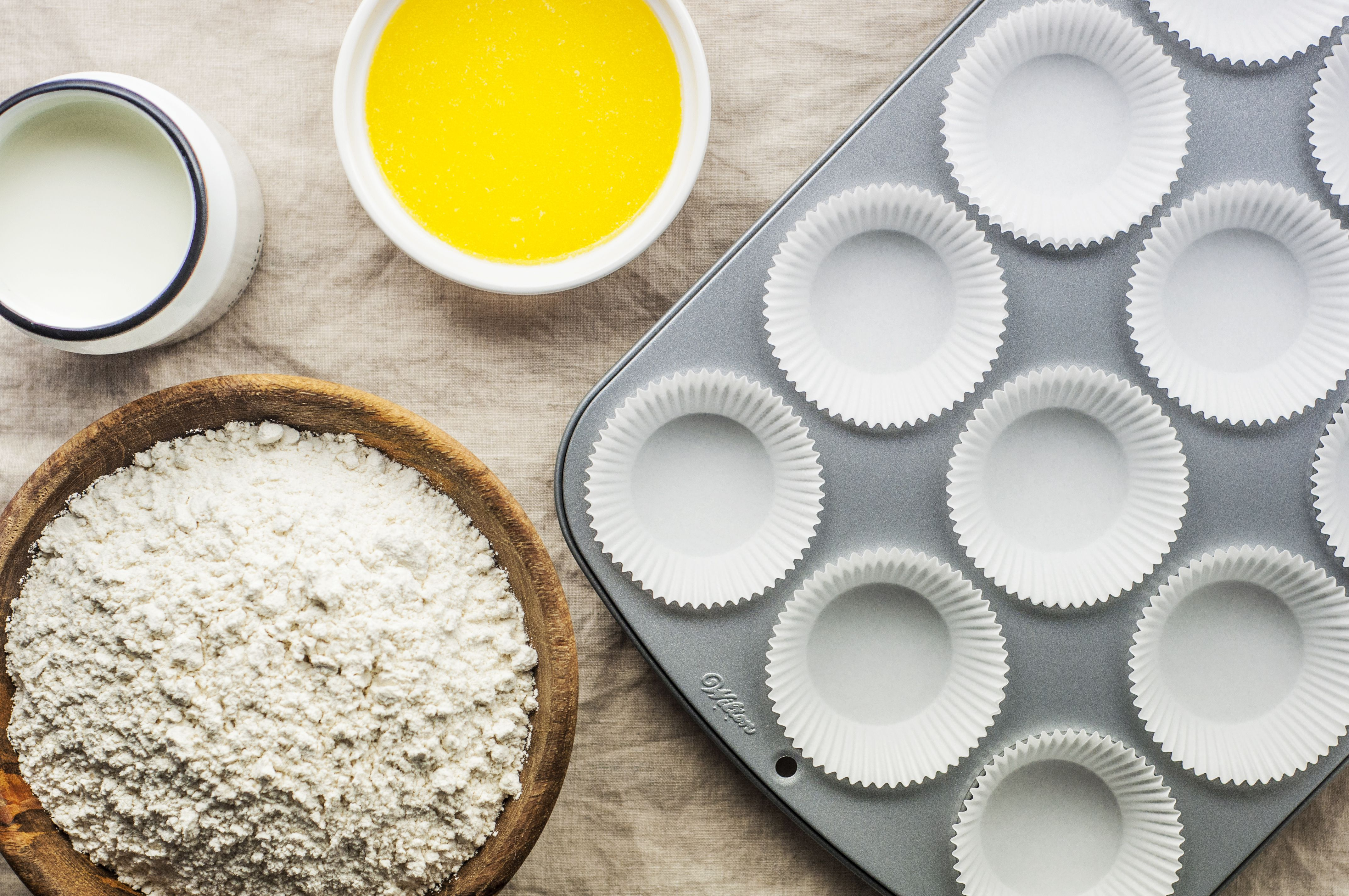 Paper cupcake liners in a muffin tray