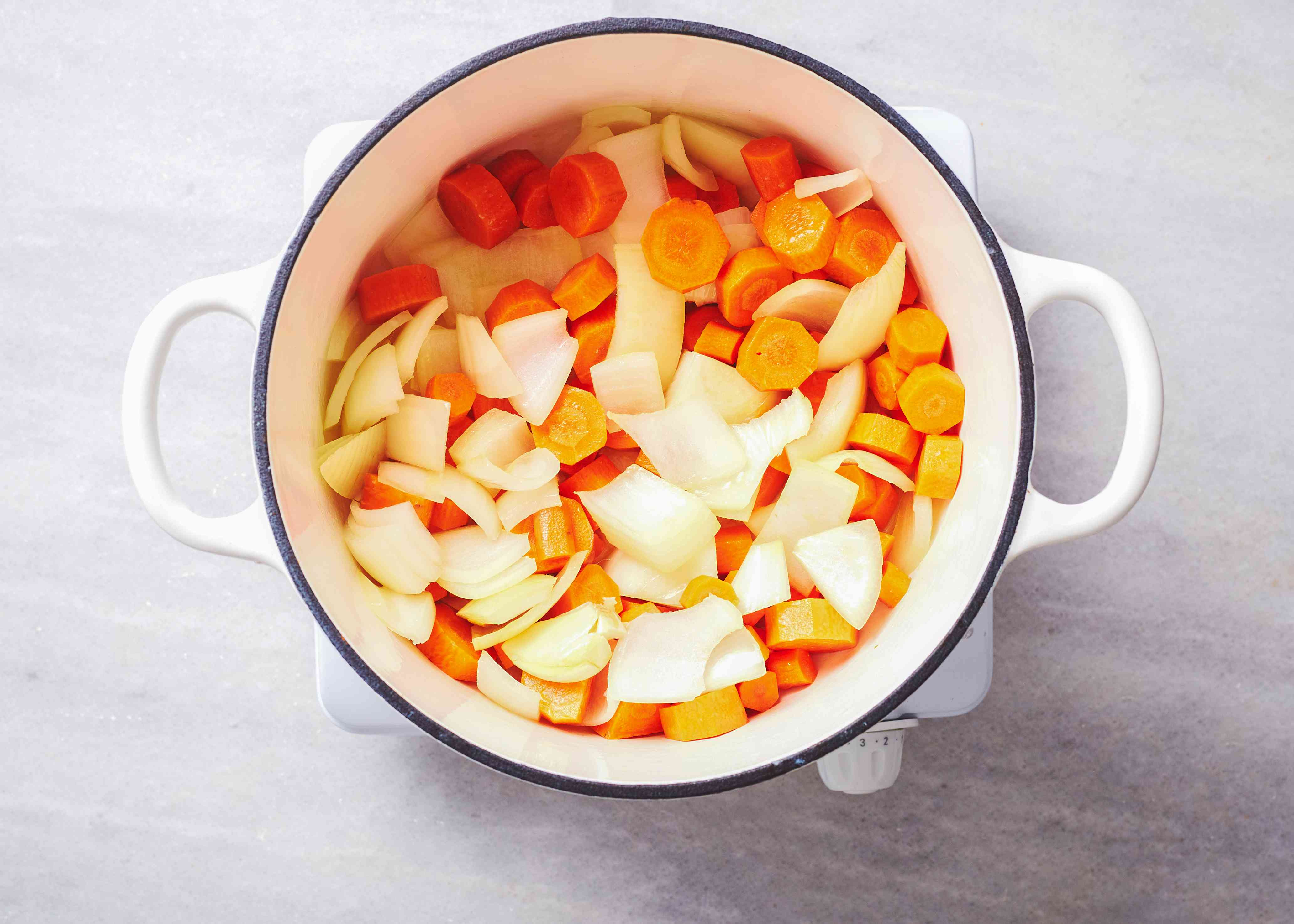 onions, carrots and garlic in a pot