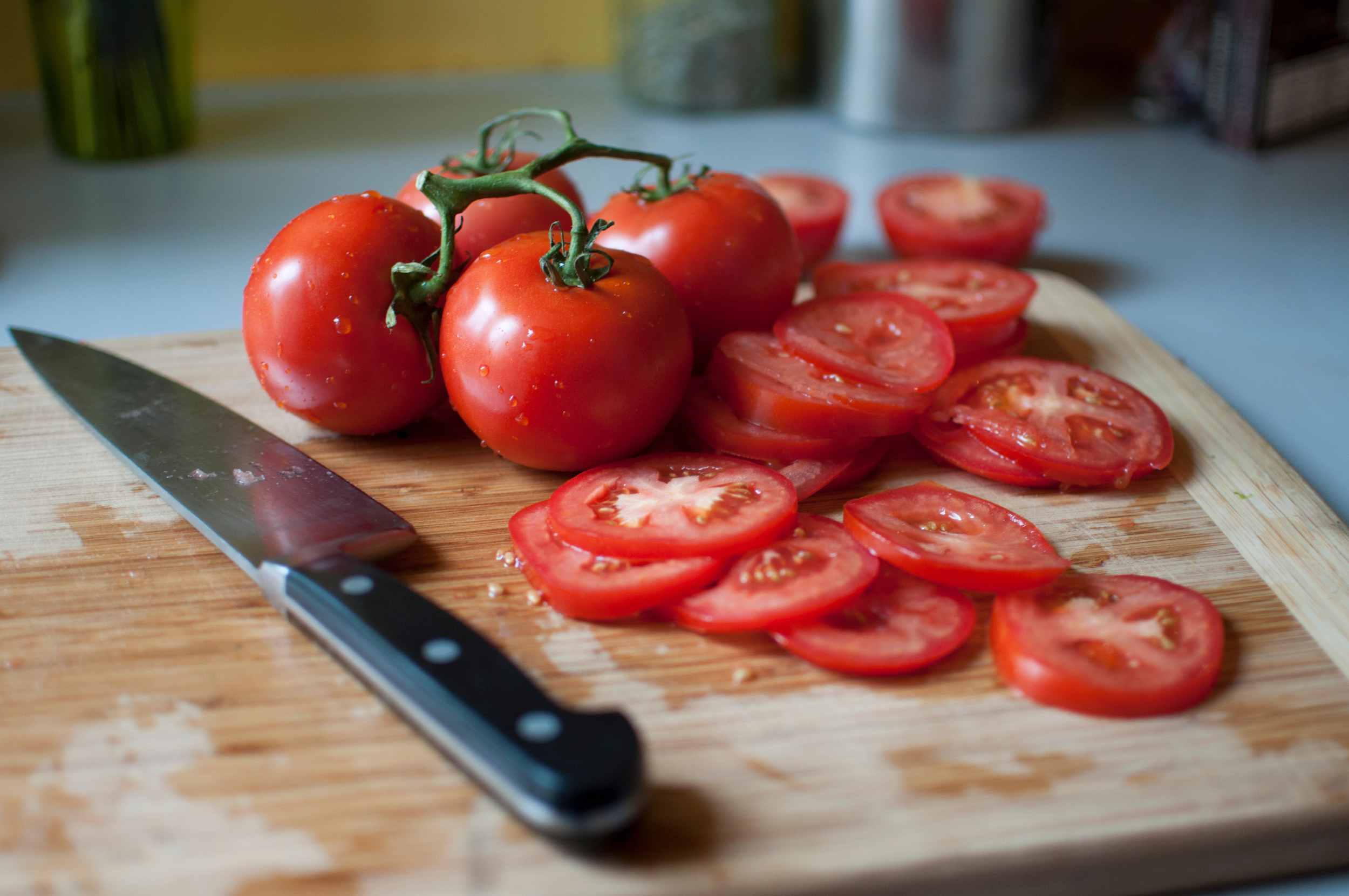 Sliced tomatoes on cutting board