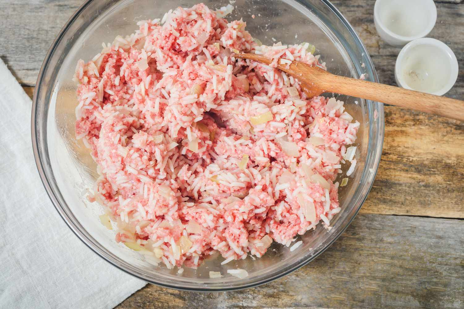 Mixed onion, meat, and rice in a bowl