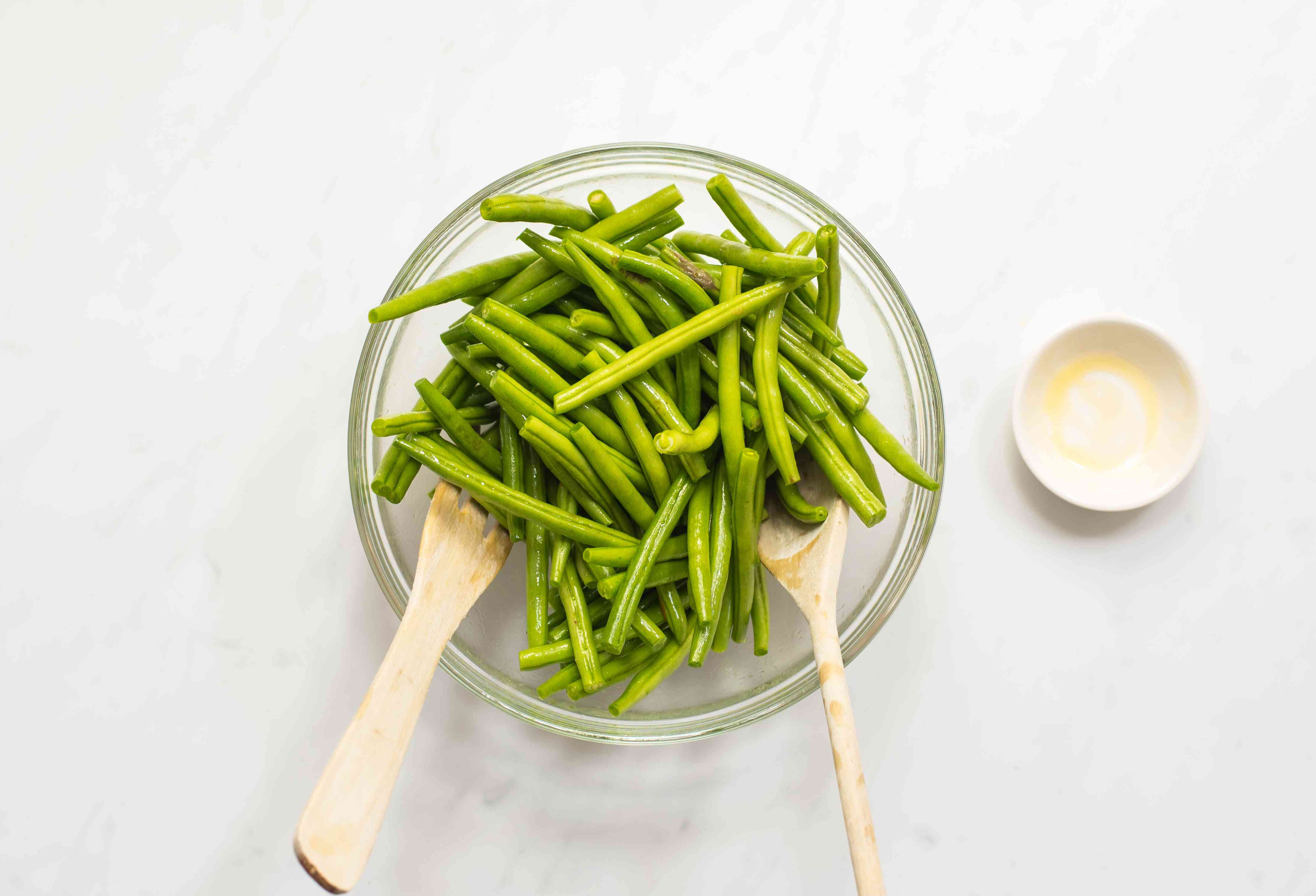 Put green beans in large bowl