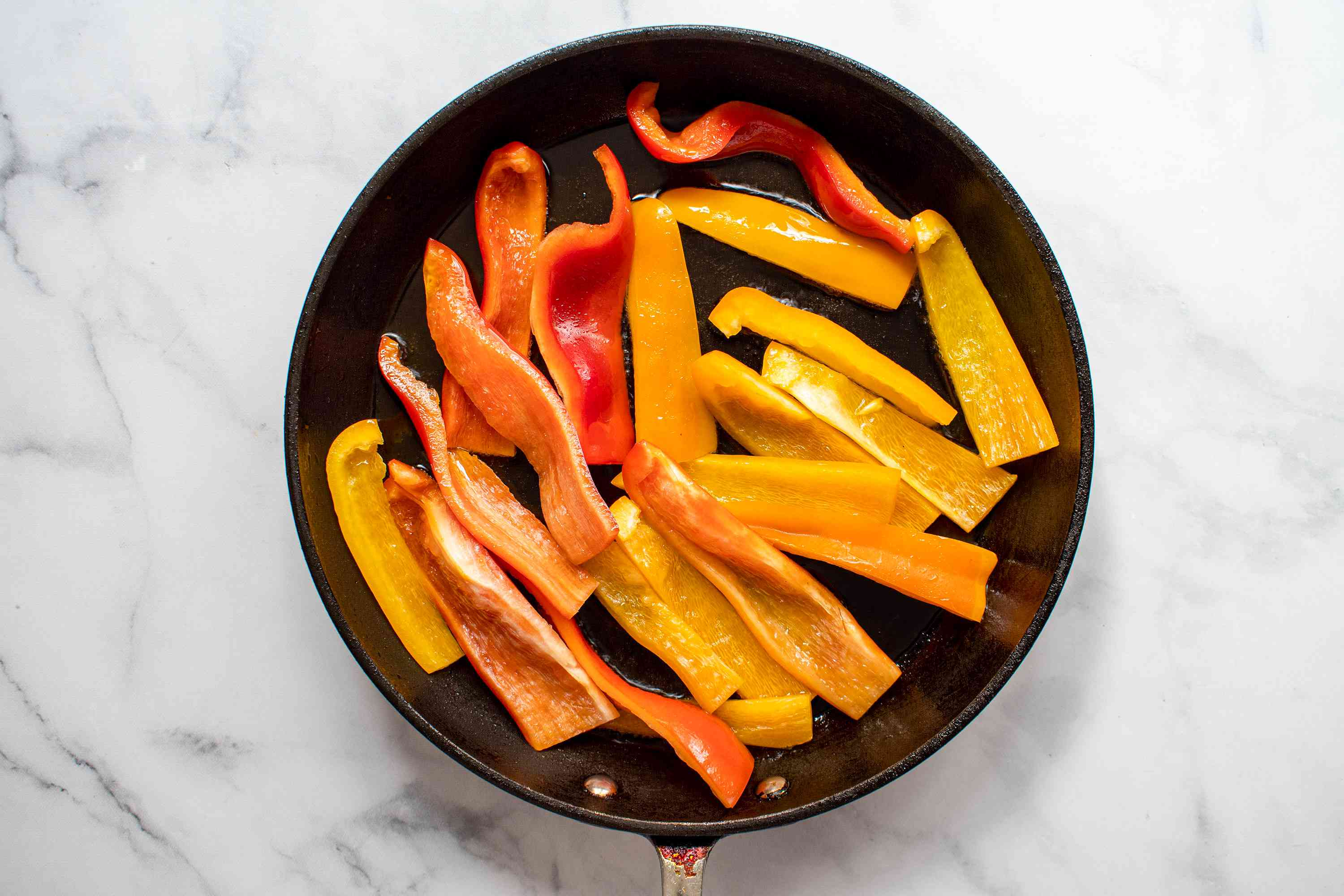 add the sliced peppers to the skillet
