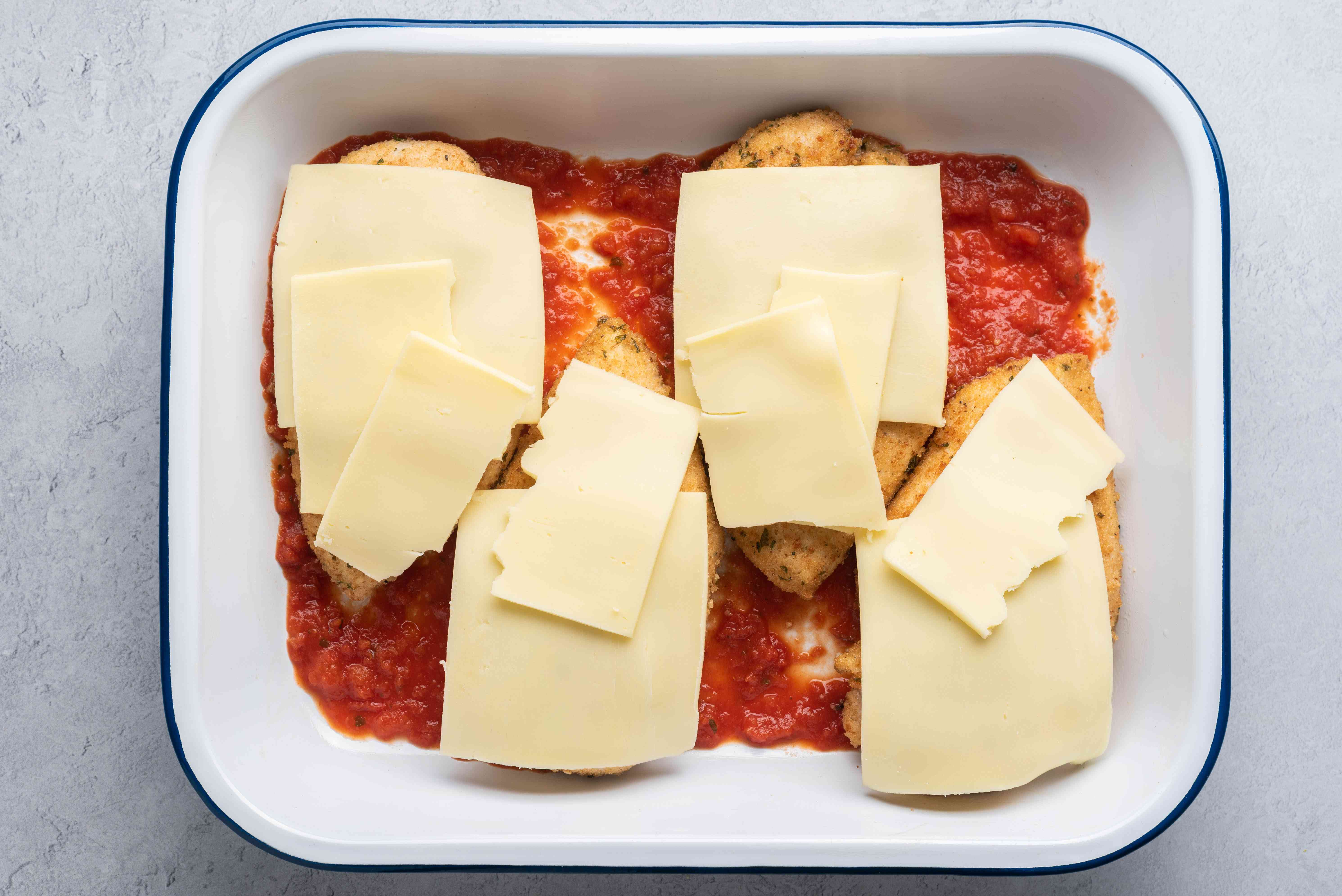 sauce, chicken and cheese in a baking dish