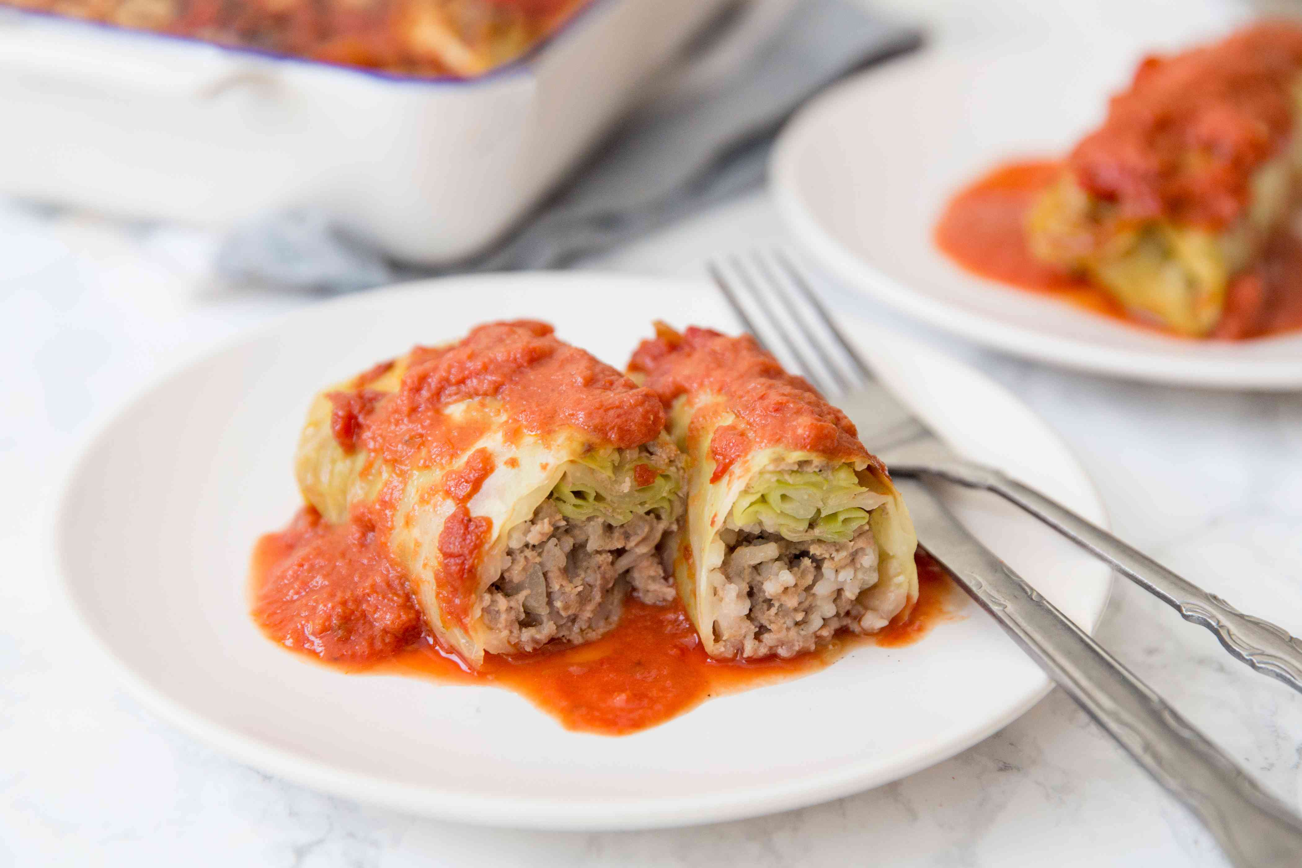 Stuffed Cabbage Rolls With Ground Beef and Rice on a white plate