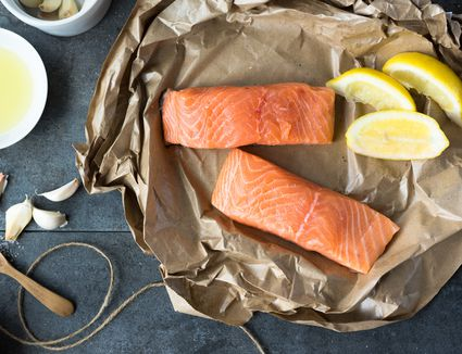 salmon, lemon, garlic on parchment paper