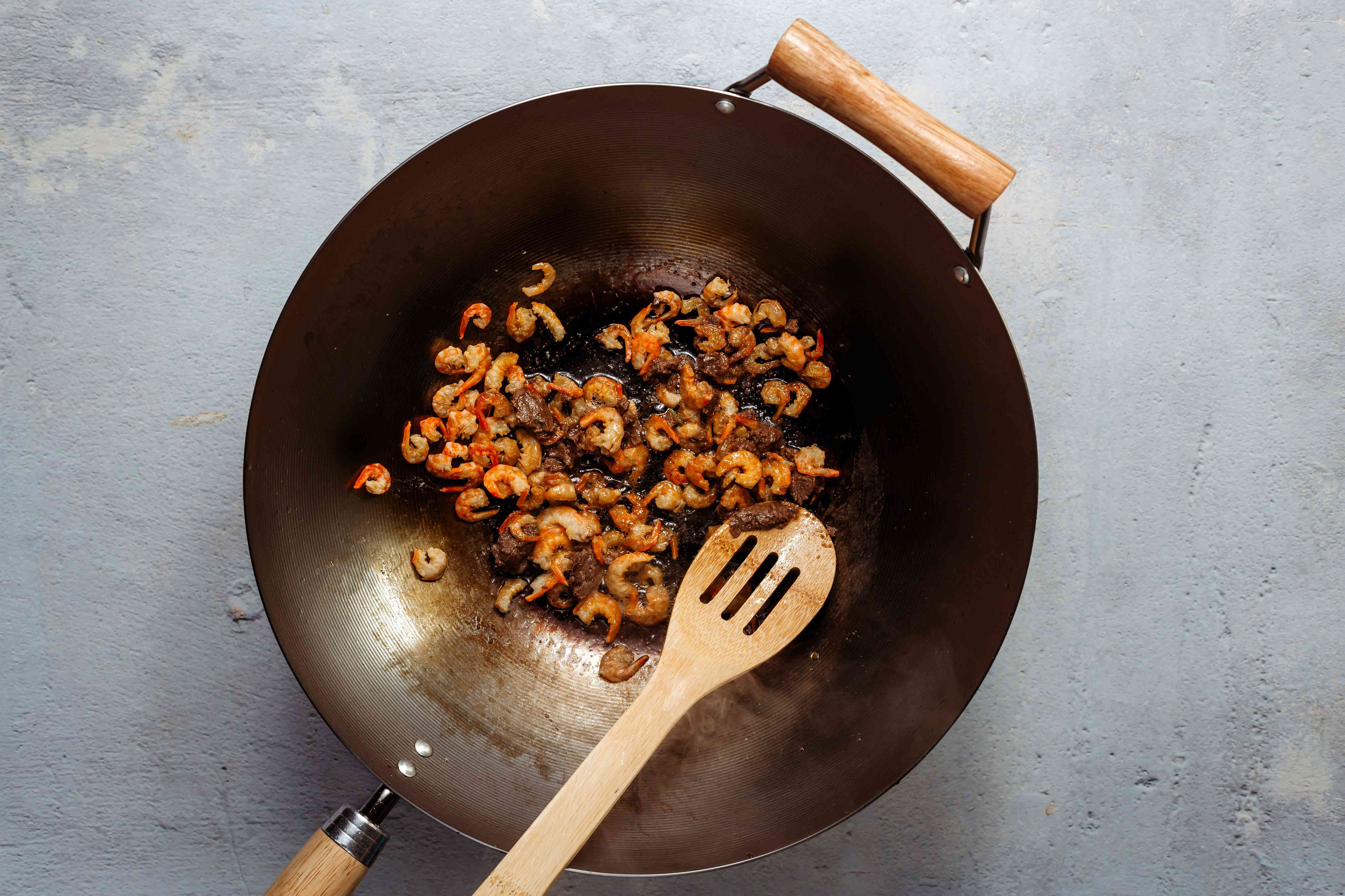 Fry the dried shrimp and the belacan together
