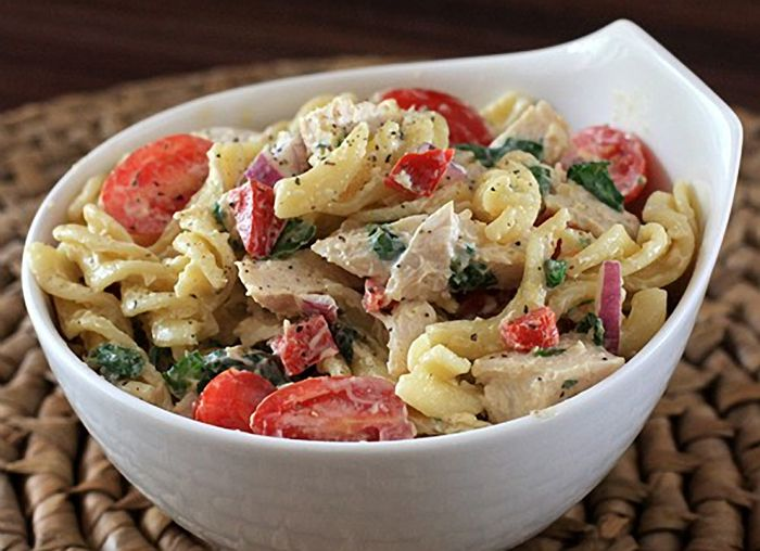 Pasta salad with chicken and spinach