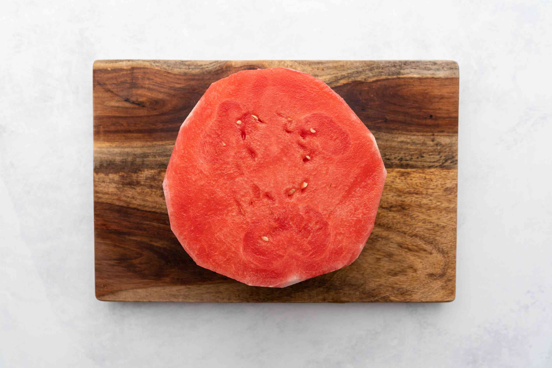 Watermelon trimmed on a cutting board
